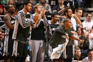 The Spurs bench celebrating.