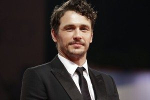 James Franco in a black suit and tie, chest up
