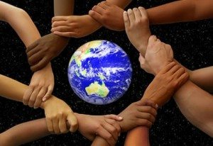 Cultural Divides. Picture of different ethnicities holding hands around the globe.