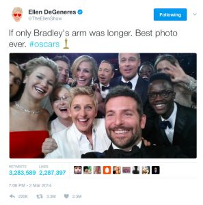 This is an image of Ellen Degeneres taking a selfie at the 2014 Oscars, which was a defining moment for social media at awards shows.